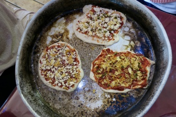homemade pizza baking at the spice farm