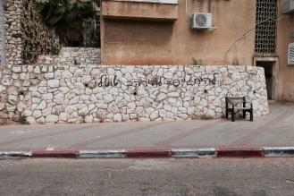 graffiti in ultra-orthodox neighborhood in Israel