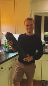 David & a massive zucchini from our garden