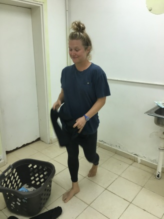 wearing abandoned clothes in kibbutz laundry room so I could wash *all* my clothes